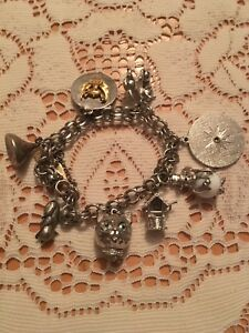 Beautiful Sterling Silver Charm Bracelet With 8 Charms