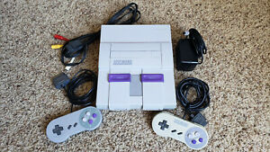Super Nintendo Entertainment System Console (NTSC-UC) hookups and controllers