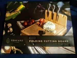 TOSCANA - Folding Cutting Board w/4 Cheese Tools. Preowned box opened but unused