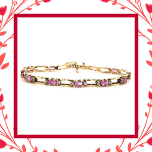 Diamond Designs 14 Karat Yellow Gold Oval Pink Sapphire and Diamond Bracelet