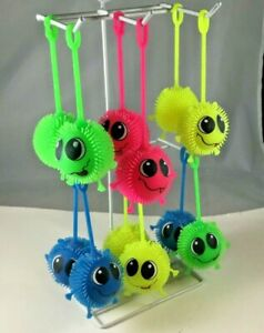 Big Eye Squeezable Puffer Ball Assorted Colors One Dozen New $11.50