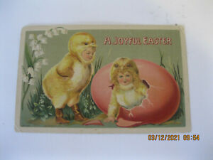 Early 1900s A joyful Easter postcard child inside egg and child dress as chick $4.00
