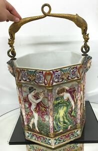 fantastic antique majolica vase with many