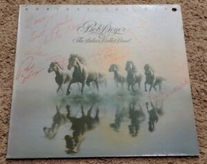 Bob Seger - Signed Against the Wind signed by Bob and Silver Bullet Band. COA.