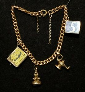 Vintage  gold charm bracelet with hallmarked links and four charms 20g