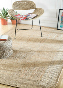 Indian Hand Woven Beige and Brown 5'3X7'6 ft Jute Solids Pattern Area Rug