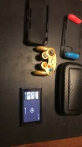 Nintendo Switch Console + GameStop Gold Controller + Case GripCase And More.