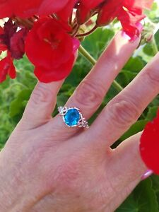 Bright Oval Tropical Blue Topaz Love knott Ring, Sterling Silver,  Size 6