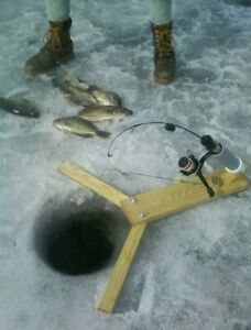 Ice fishing pole automatic hook setter. Fishing tackle for ice fishing rods.