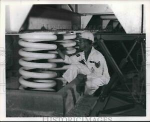 1969 Press Photo Worker Inspects Large Springs inside NORAD $19.99