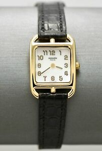Ladies designer wristwatch by Hermes with 18k yellow gold case & mother of pearl