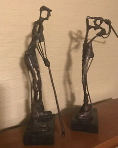 Pair of metal sculptures of golf players. Man And Woman 13quot; Tall $29.99
