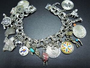 VINTAGE STERLING SILVER CHARM BRACELET WITH 18 CHARMS 57.4 gms