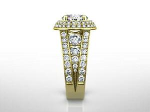 CLASSIC DESIGN 4.0 CT D VS1 ROUND CUT DIAMOND RING 18 K YELLOW GOLD SIDE STONES