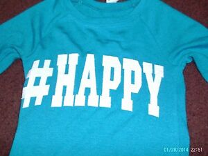 justice-- girls size 5--tropical blue top says HAPPY in a white glitter--nwt