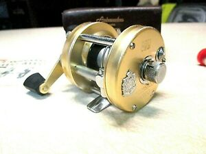 ABU GARCIA AMBASSADEUR FISHING REEL W LEATHER CASE RARE CHAMPANGE 5000 D