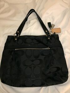 preowned black coach purse with teal interior