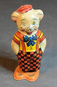 j co winking pig wind up tin toy