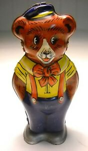 vintge happy bear tin wind up works and great
