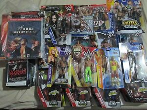 WWE FAN LOT OF DVDS MATTEL ELITE FIGURES TSHIRT ACCESSORY NWO STING HOGAN ROCK