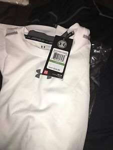 Under Armour Compression Gear Men's large 4 Shirts 1 Shorts