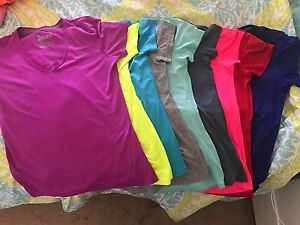 womens nike dri fit v neck multiple colors. 9 shirts for $75 .