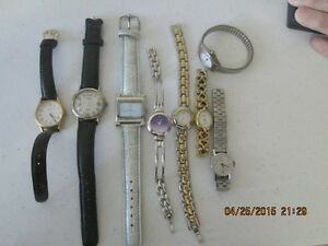 Assorted watches (8) leather bands and bracelet styles TimexGucci SharpArmitr