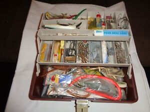 PLANO TACKLE BOX FULL OF PRE-OWNED SALT WATER LURES AND EQUIPMENT