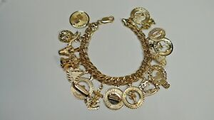 GOLD CHARM BRACELET & CHARMS  Solid 14K Gold  31.9 Grams Not Scrap