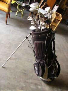 Bullet golf bag with an assortment of golf clubs including Bullet Arnold...