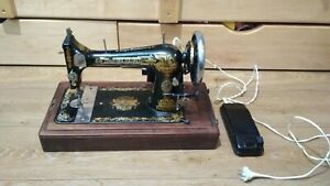 Antique sewing machine Singer. $350.00
