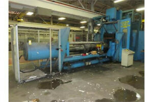 Reinhardt Rubber injection molding machine with press and die changer
