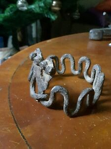 AN EXCEPTIONAL GAN IRON BRACELET WITH 2 SNAKES FROM THE LOBI TRIBE