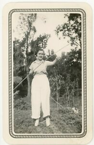 VTG TEXAS 1935 PHOTO YOUNG WOMAN IN SLACKS HOLDING FISHING ROD AND TINY FISH