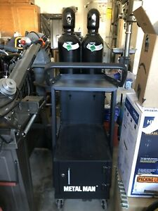 welding cart with cabinet and two bottles of 100% argon and 75% argon25% co2 $845.00