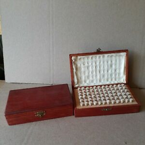 2 vintage wooden case with 144 glass vials of Watch repair parts $25.00