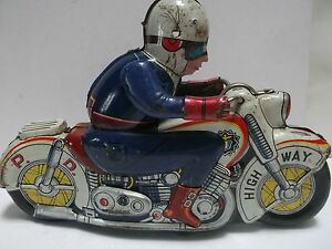 tin motorcycle with policeman toy
