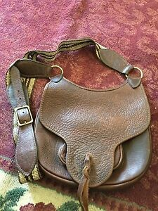 brown bufflo hide purse with 3 pouches used as purse or black powder bag
