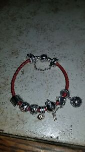 Authentic Pandora red leather bracelet With 9 Charms with gold Medium.