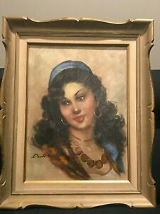 Vintage Gypsy Woman Oil Painting signed and Framed. Beautiful piece C $350.00