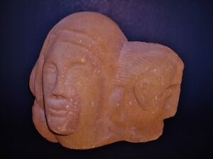 Two Carved Heads on a very Heavy 12