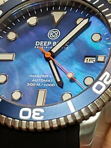 NEW  DEEP BLUE MASTER 1000300FT AUTOMATIC.BLUEBLUEBEZELMOTHER OF PEARL DIAL