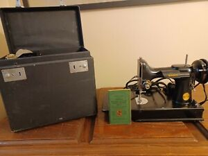 singer featherweight sewing machine 221; 1946 with case amp; accessories. $400.00