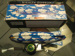 vintage tin stealth zeppelin wind up toy