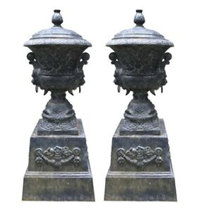 Monumental Antique Covered Cast Iron Urns on Plinths with Lion Head Handles