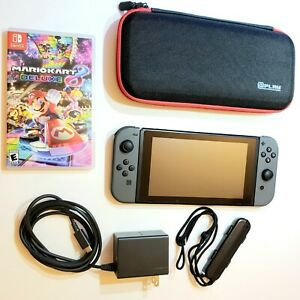 Nintendo Switch Console Bundle w Mario Kart 8 Deluxe Joy Cons Case