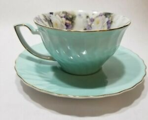 PORCELAIN TREASURES BETTY PLATNER GREEN WITH WHITE ROSE FLOWERS TEA CUP