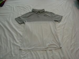 Pre owned Under Armour Grey and White Youth Large Golf Shirt. In good condition. $5.00
