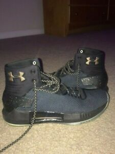 Barely Used Gold and Black Under Armour Shoes $50.00