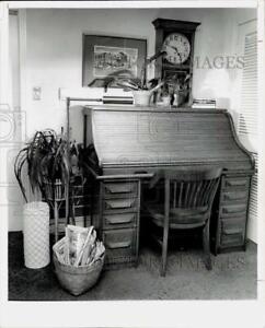 1975 Press Photo Antique roll top desk used as living room accessory.